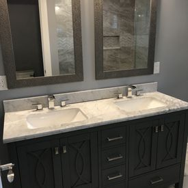 view of a bathroom sink installed on top of a cabinet