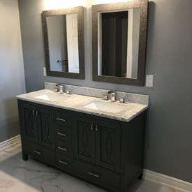 bathroom sink installed on top of a cabinet