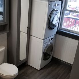 bathroom fitted with front loading washing machine
