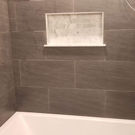 View of a tiled shower cabinet wall