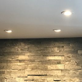 Pot lights and stone wall