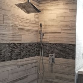 bathroom shower area with installed tiles