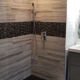 view of shower area with installed tiles