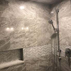 view of installed tiles on the bathroom walls