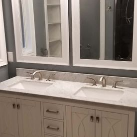 newly installed bathroom sink with cabinets